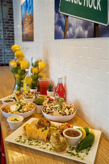 table of tacos, burrito bowl, drinks and burrito