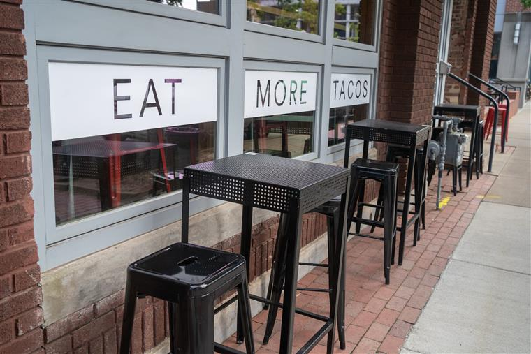 outside window seating with stools at Rock City Taco