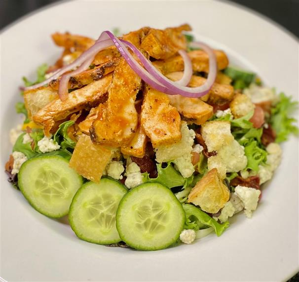 chef salad with cucumbers, blue cheese, croutons and chicken