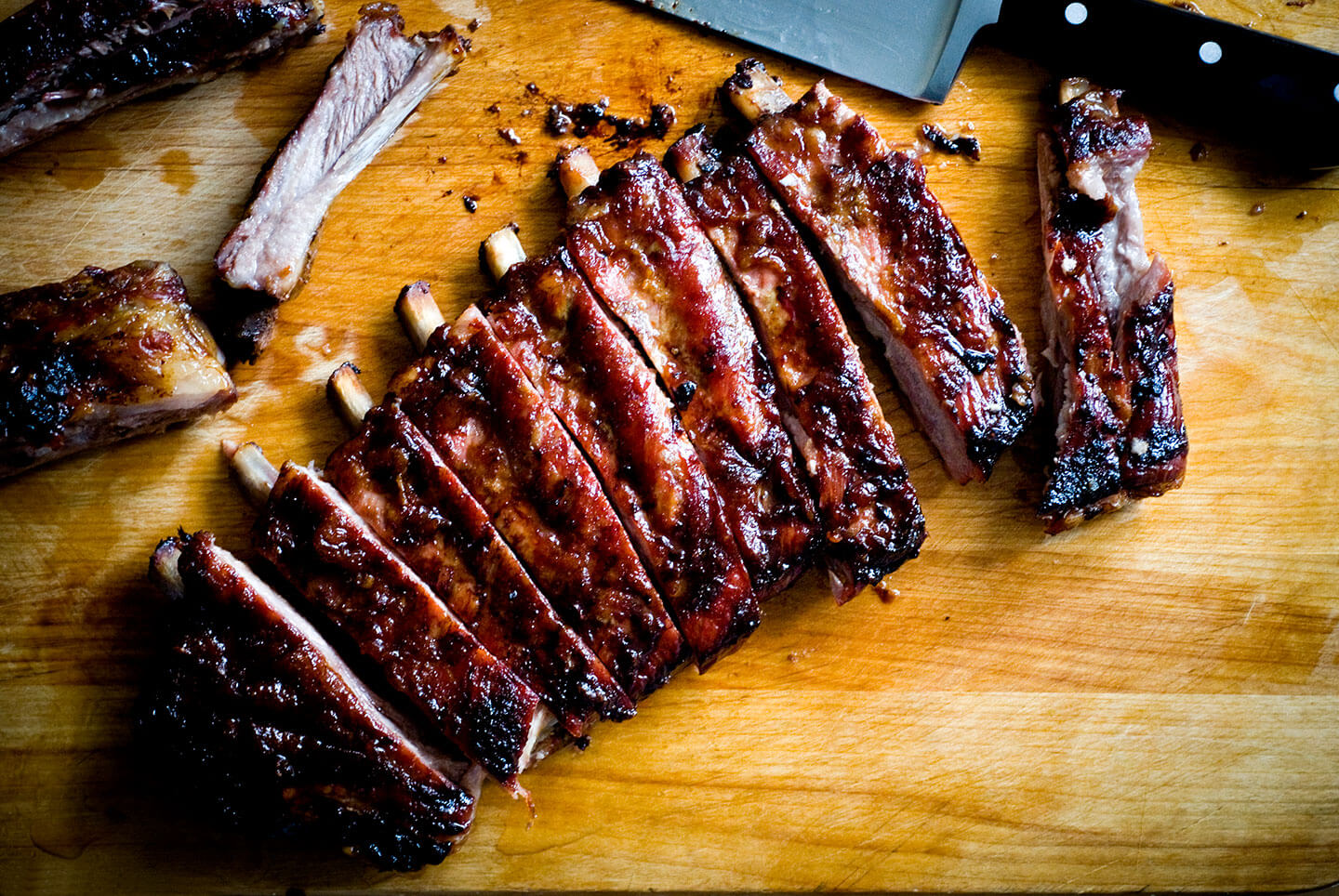 rack of ribs on a table with barbecue sauce