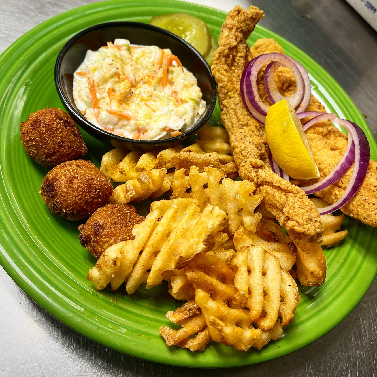 fried fish with hushpuppies and waffle fries