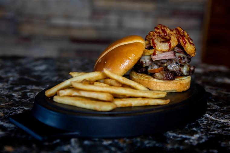 double down burger with onion rings, bacon, and fries
