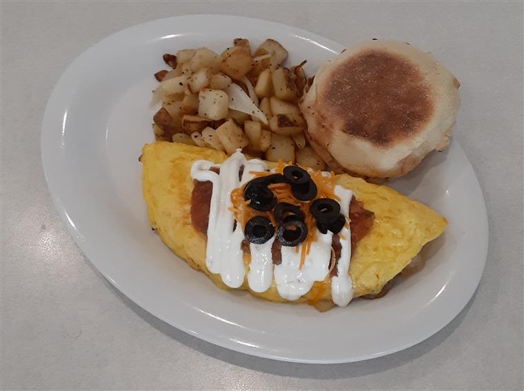 Omelette Ole: 3 egg omelet with green pepper, onion, sausage, homemade salsa and cheddar. Topped with sour cream, salsa and black olives. Served with home fries and a biscuit.