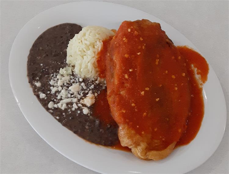 Chili Rellenos: Poblano pepper stuffed with queso fresco served with rice and beans.