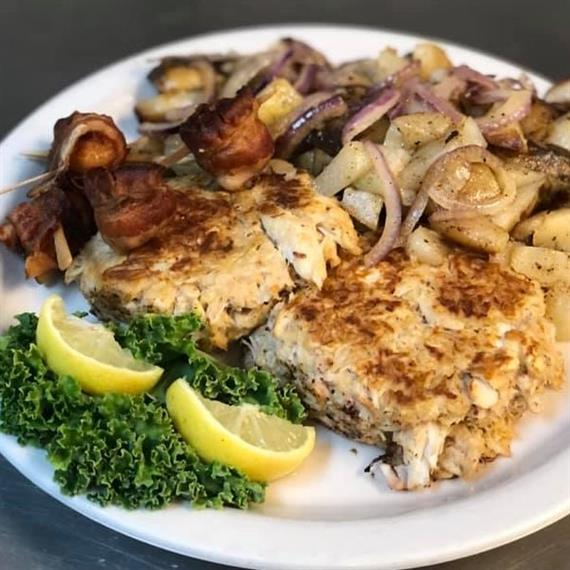 breaded pork chops with potatoes and onions