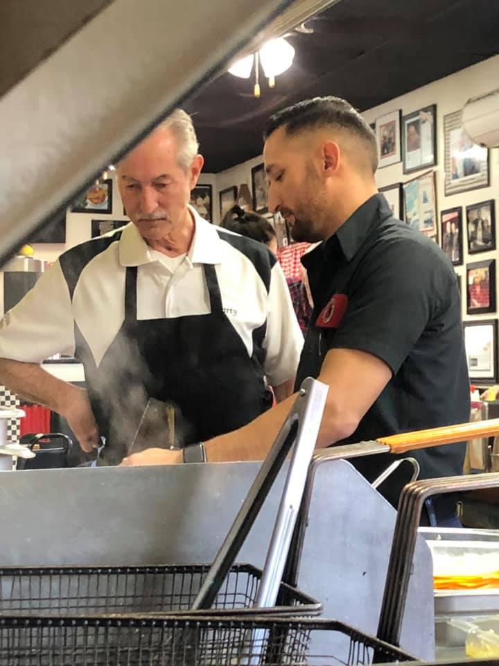 two men prepping in the kitchen