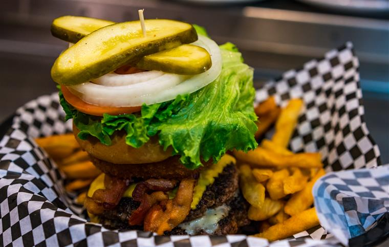 Charlie's Classic Burger: Two 3 oz Certified Angus Beef® patties with lettuce, tomato, onion, and pickles on the side