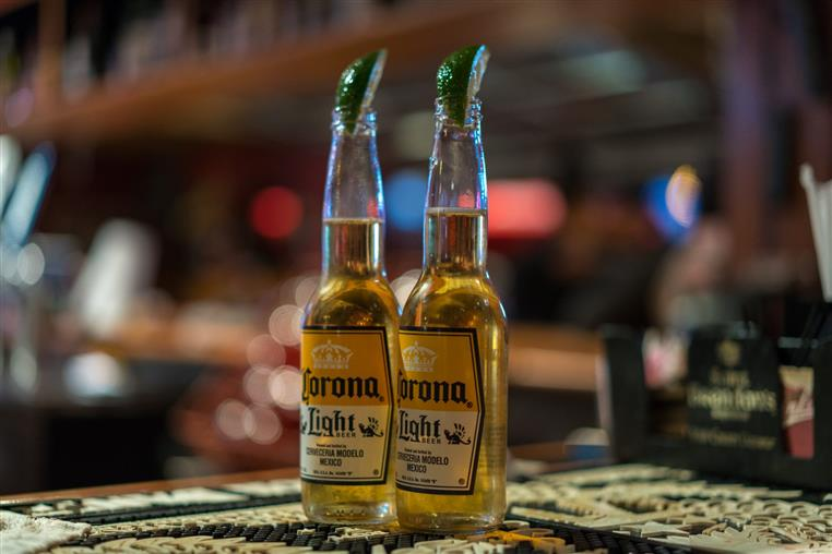 two bottles of corona light with lime