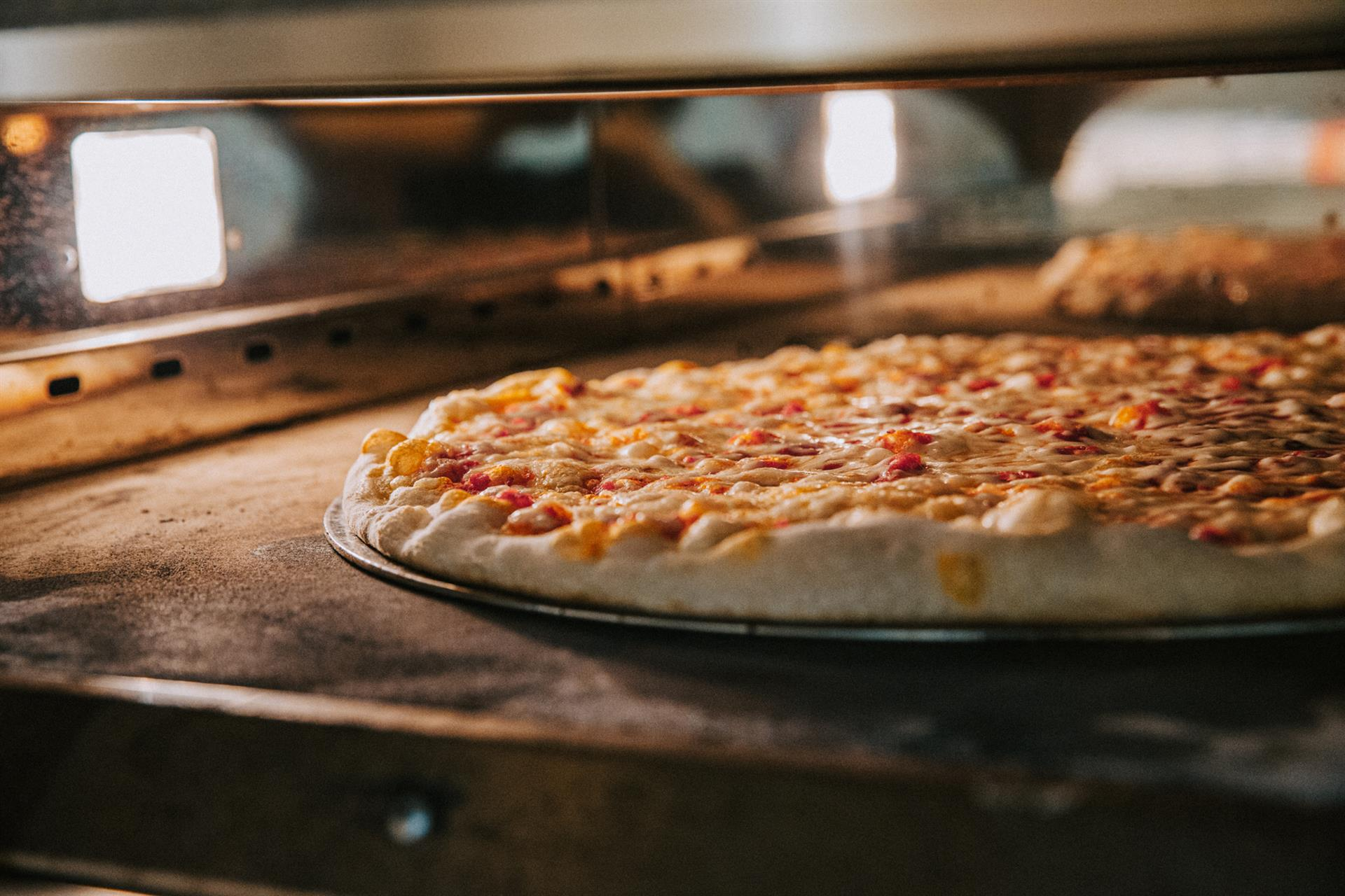 cheese pizza cooking in the oven