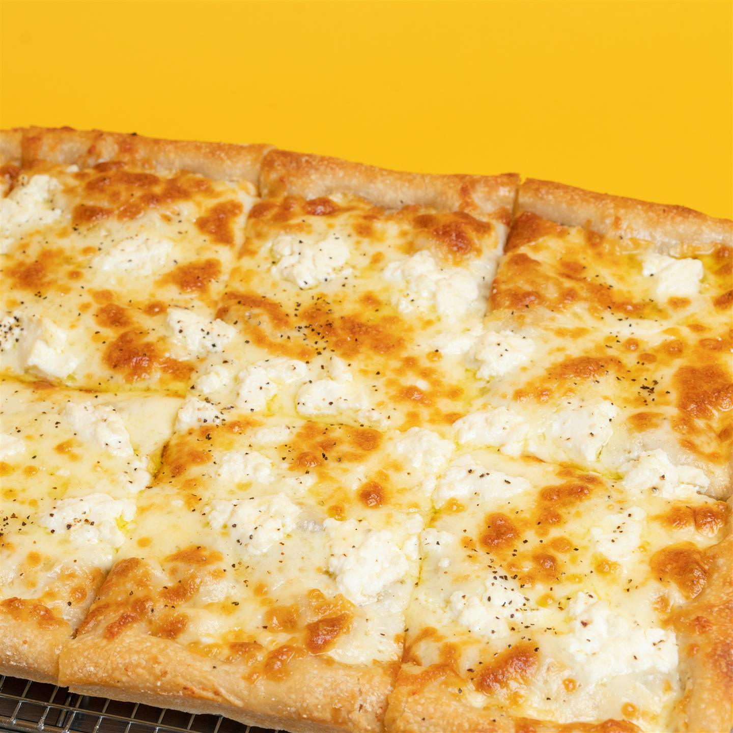 square pie with ricotta and mozzarella cheeses and no sauce