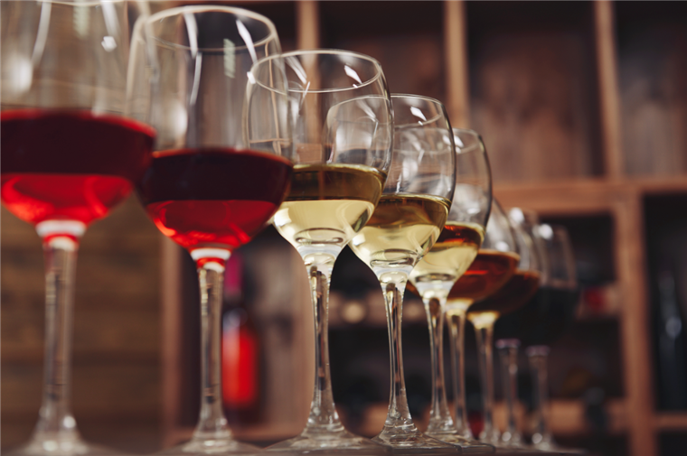 assortment of wine glasses lined up