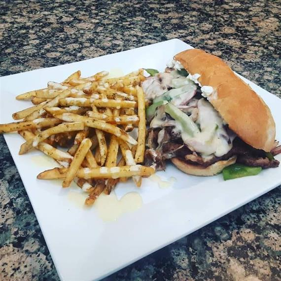 Philly Cheesesteak with Rosemary Hollande Fries