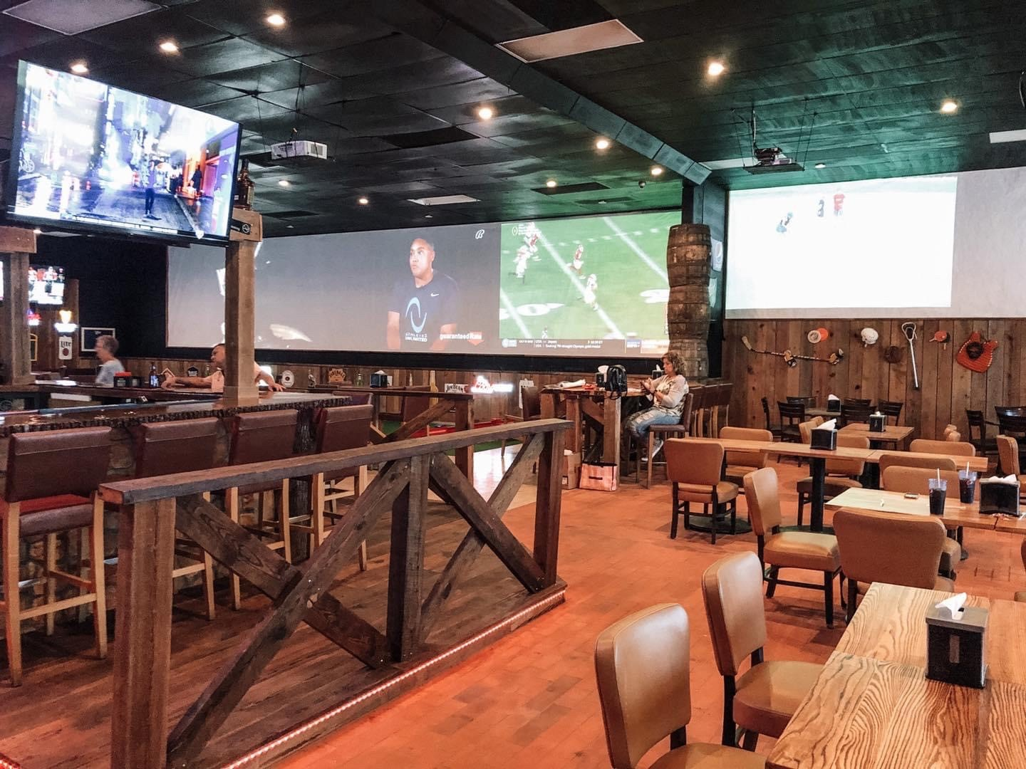 inside of the bullpen sports grill with tables and bar tvs