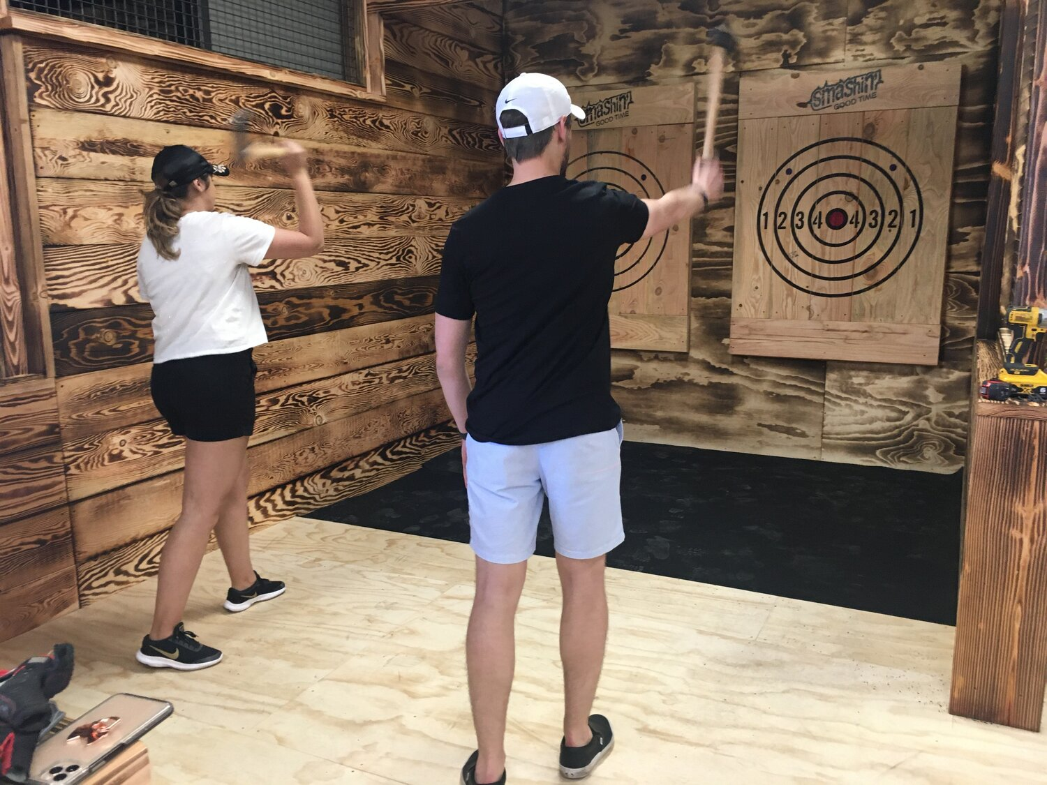 people throwing axes