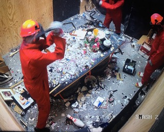 people smashing objects in room