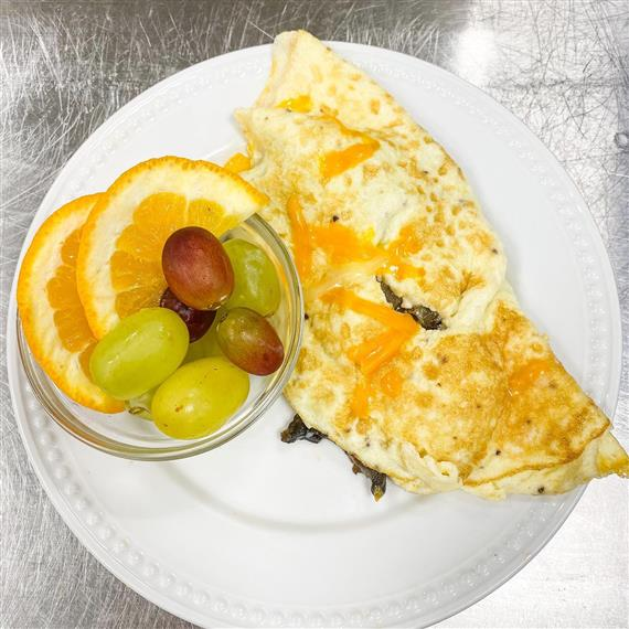 cup of fruits with omelette