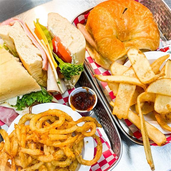 sandwichs with onion rings plus ham bagel with fries