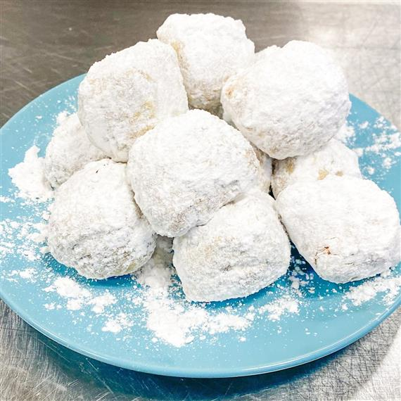 beignets on a plate on counter