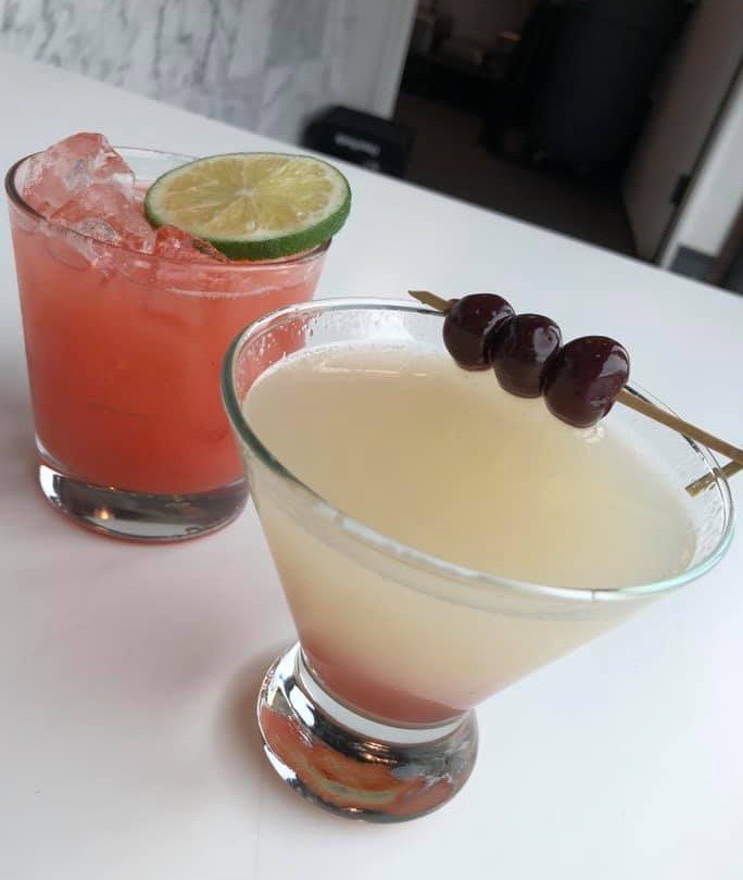 two cocktails on a bar top