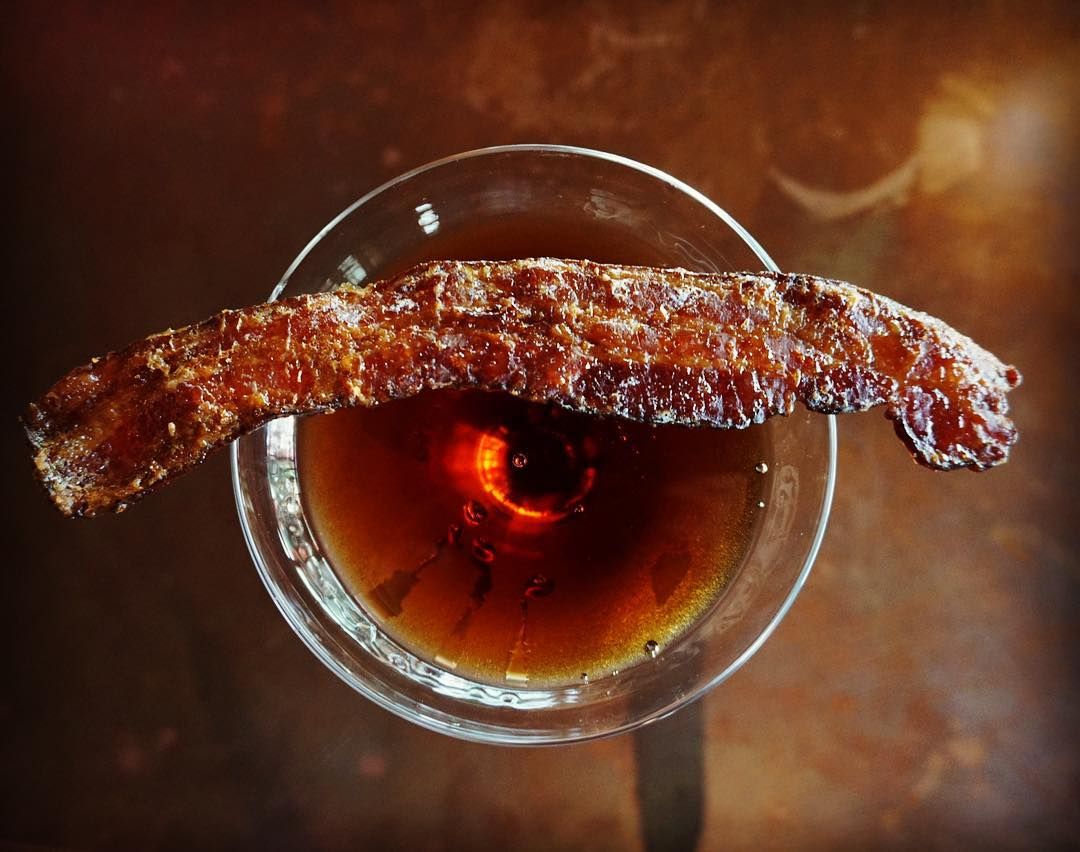 cocktail with a slice of bacon
