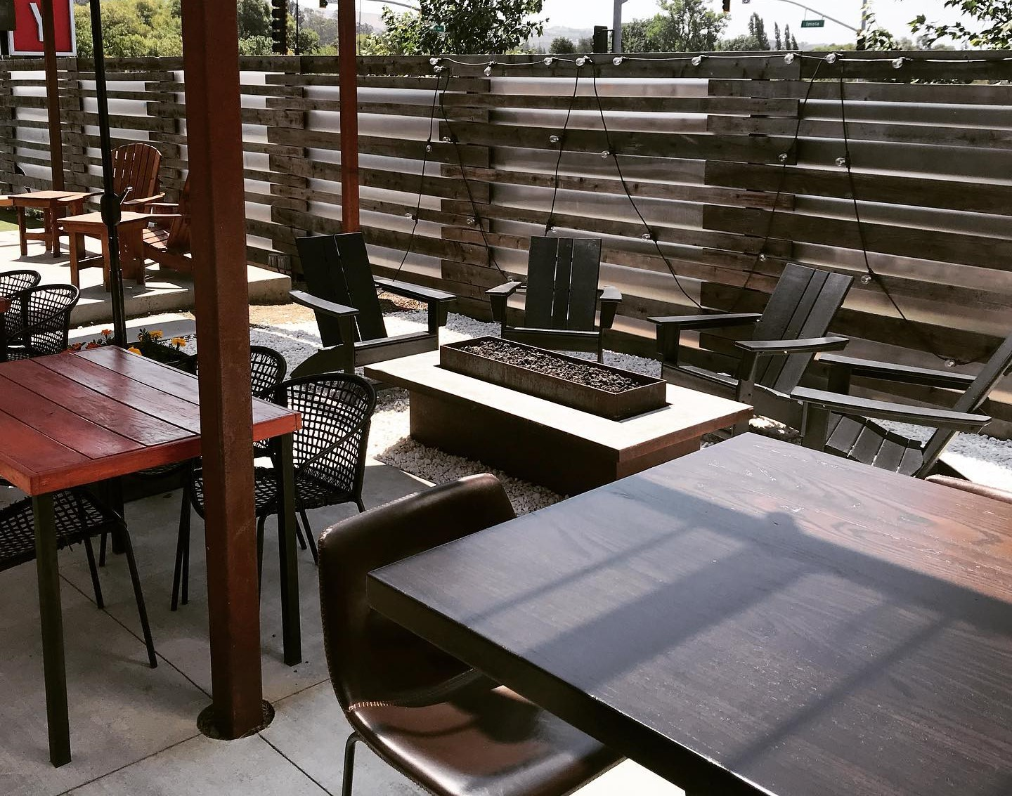 outdoor dining area with tables and chairs