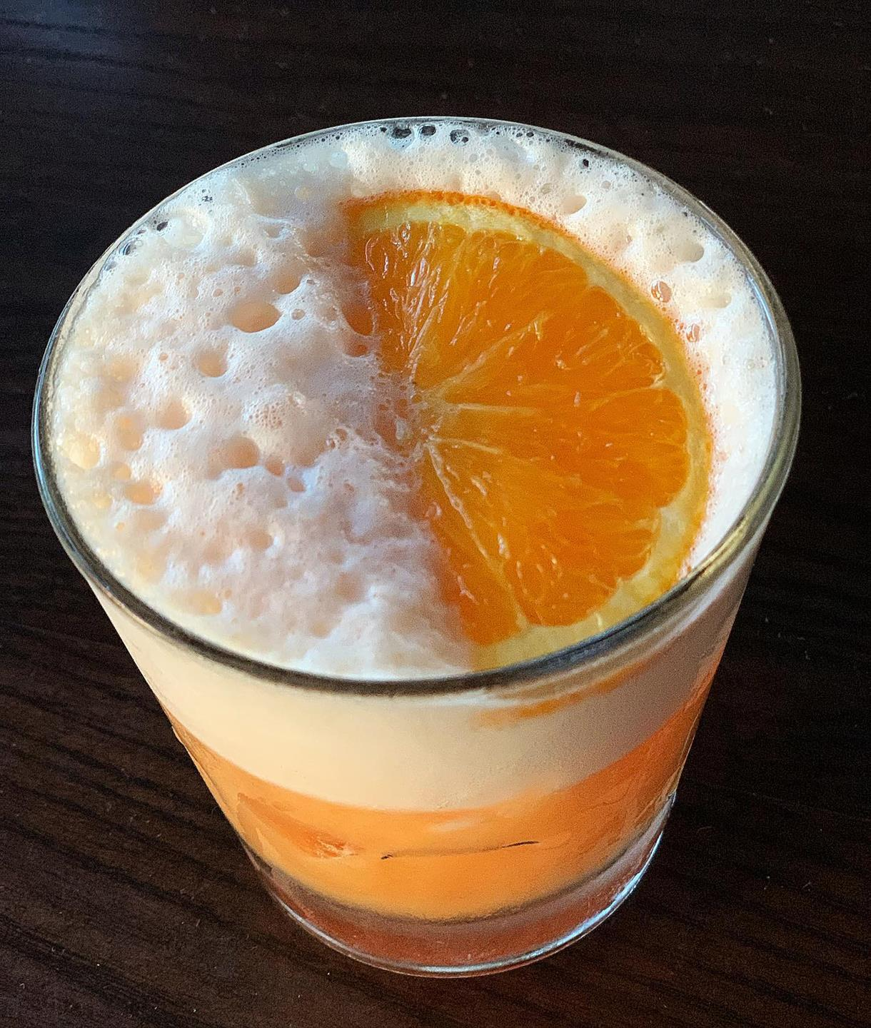 cocktail with an orange wedge