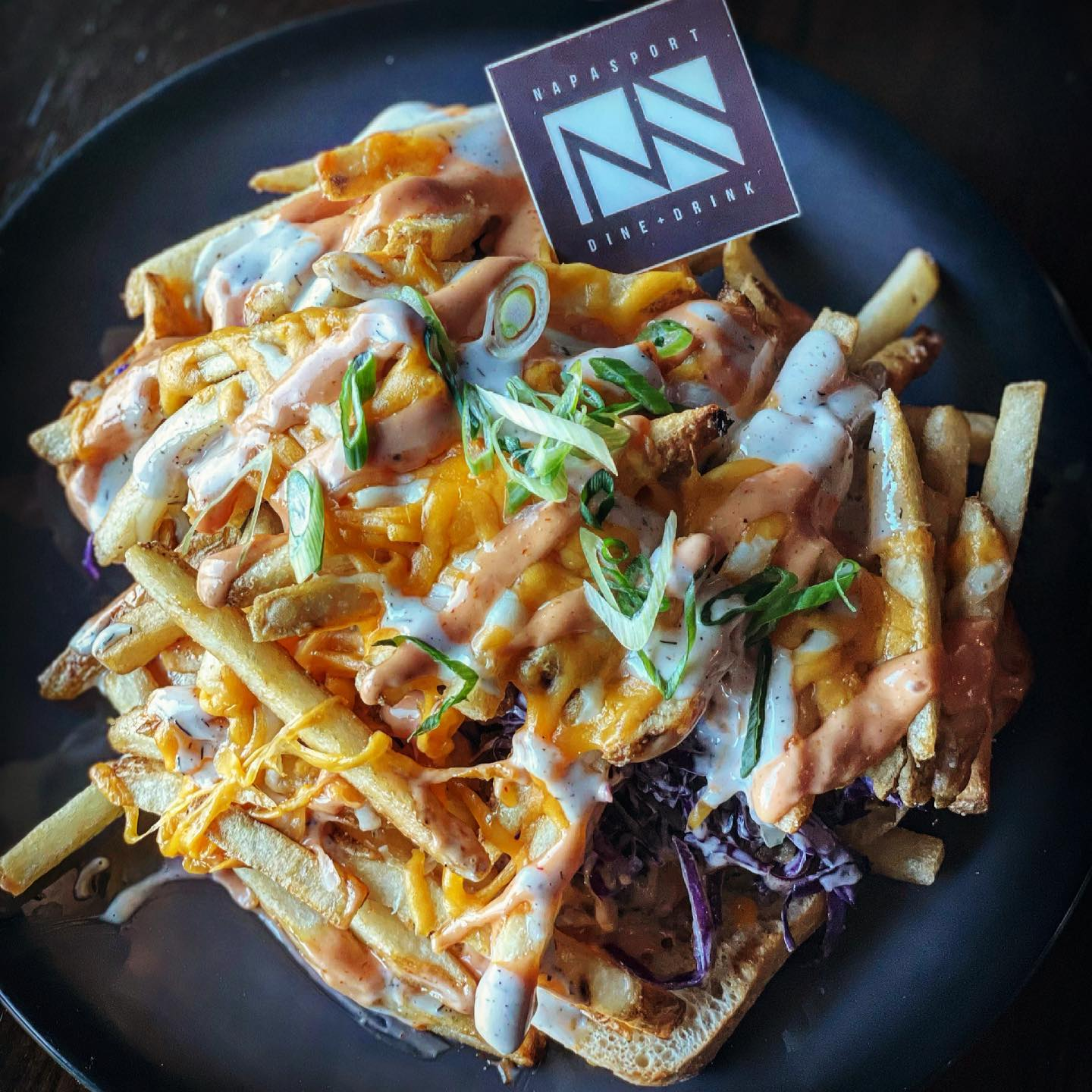 loaded fries topped with cheese and chives