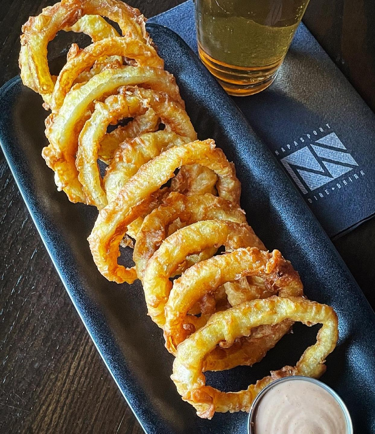 onion rings with a side of dipping sauce
