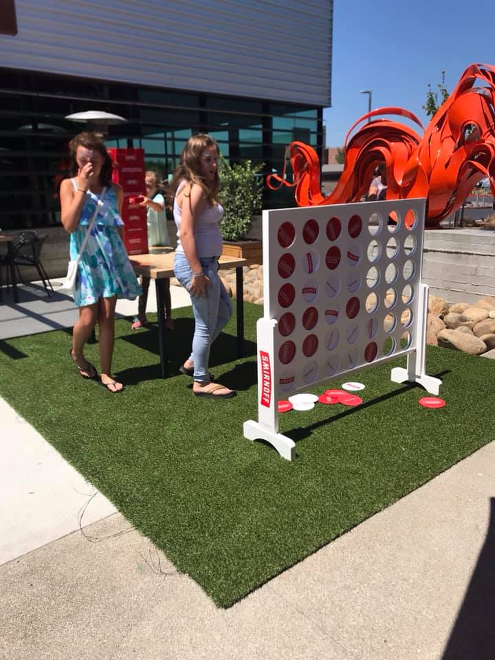 people playing giant connect four