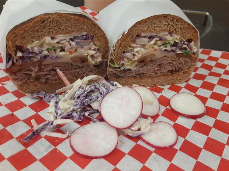 LOADED MONSTER SUB: Warm roast beef, bacon, provolone cheese, Russian dressing, homemade coleslaw, radishes