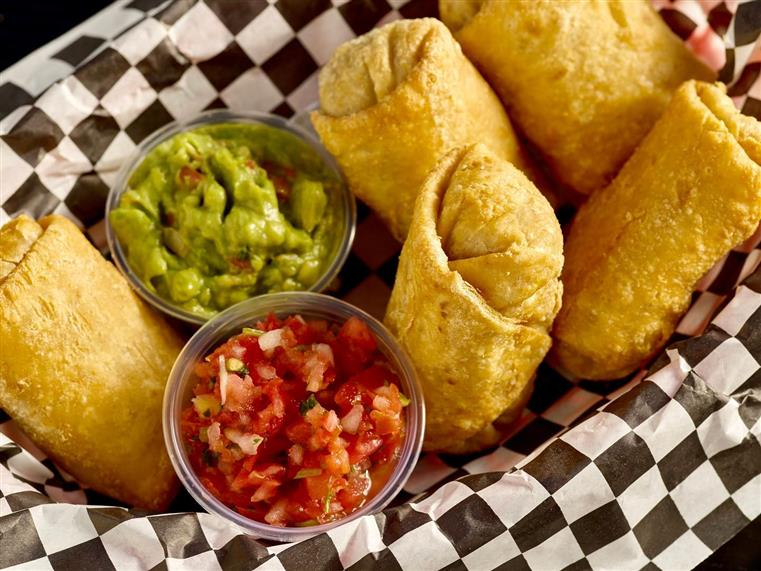 Five Mexican Egg Rolls filled with beans and cheese. Served with guacamole and salsa