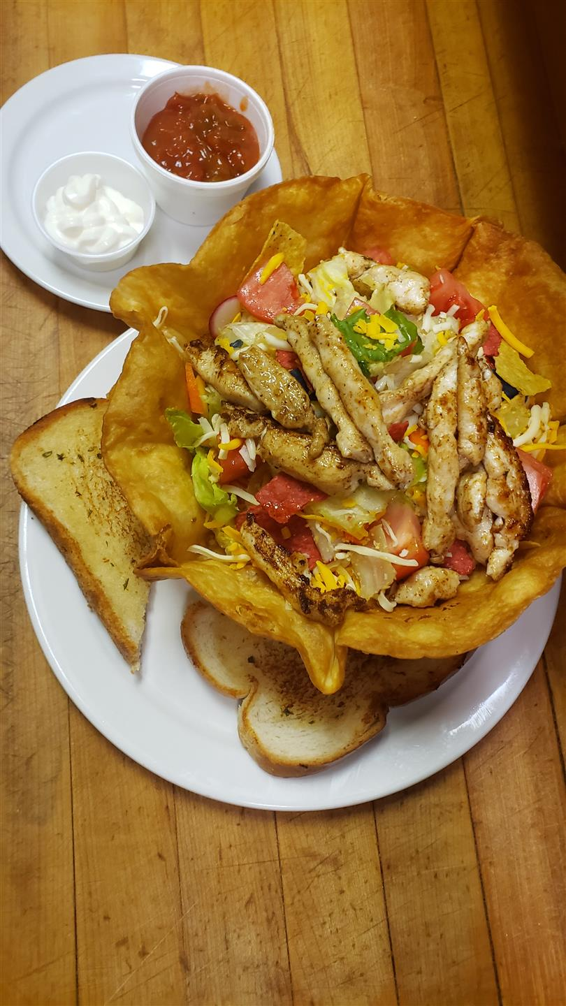 a bread bowl with a chicken salad in it