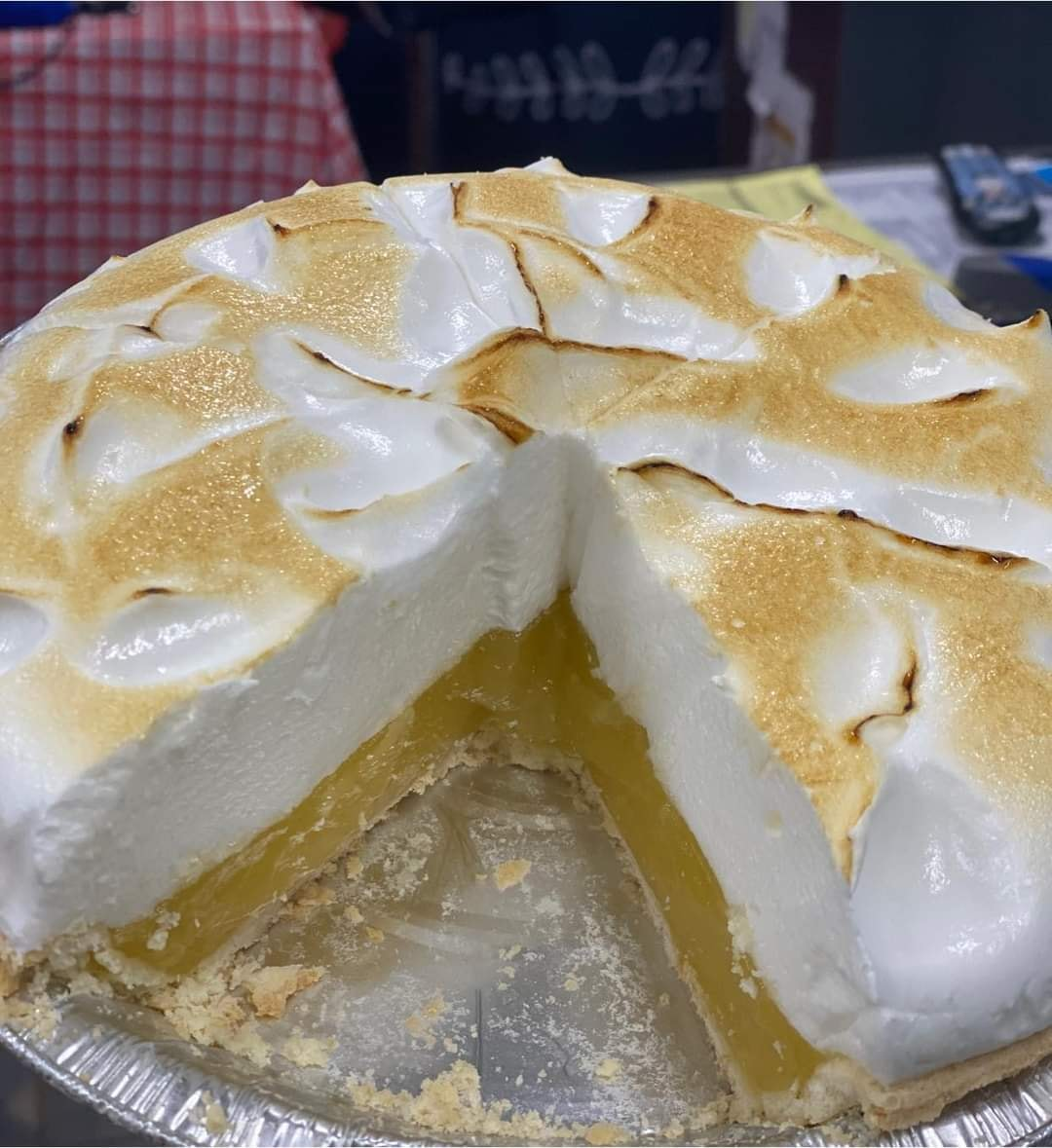 a cake with whipped cream and yellow filling