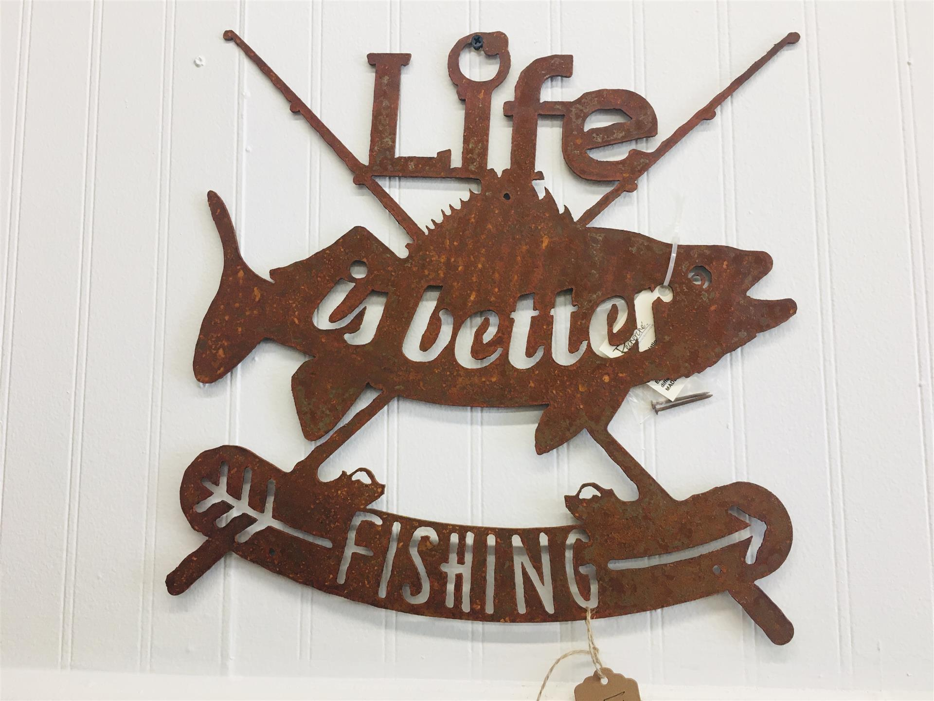sign that says life is better fishing