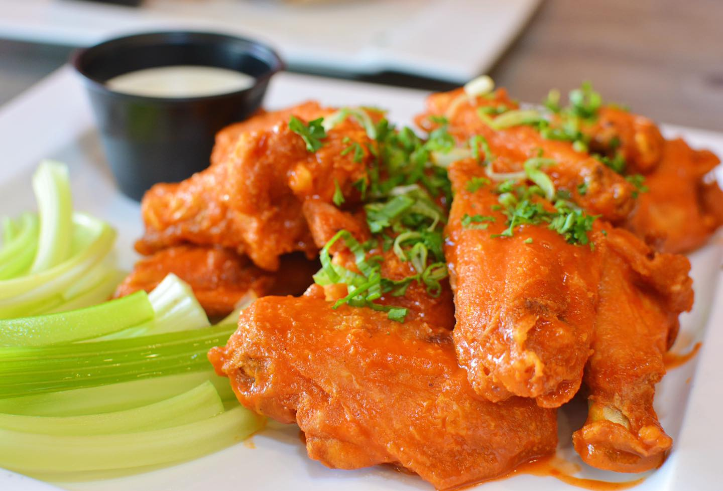 buffalo chicken wings with celery and ranch on the side