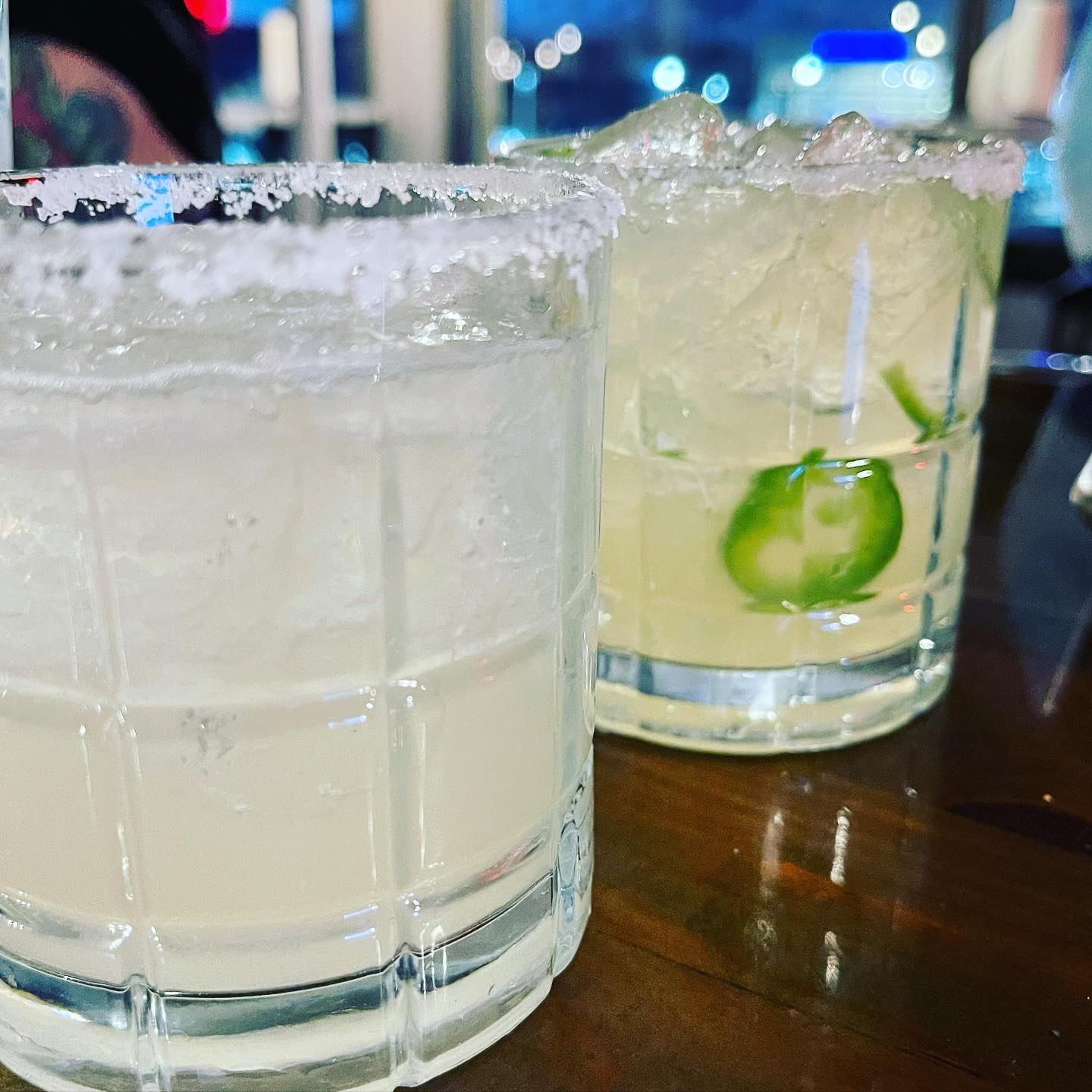 two margaritas with salted rims