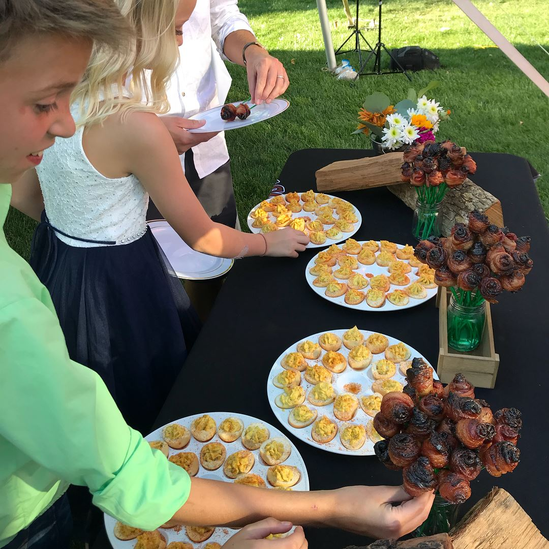 people grabbing food at catering event
