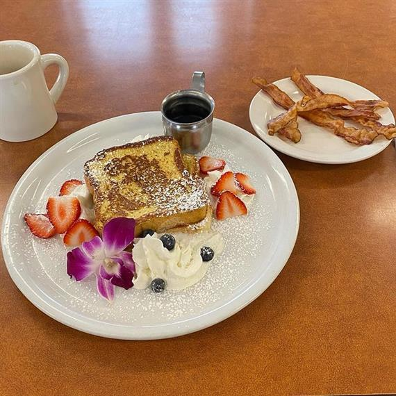 french toast with mug of coffee and side of bacon