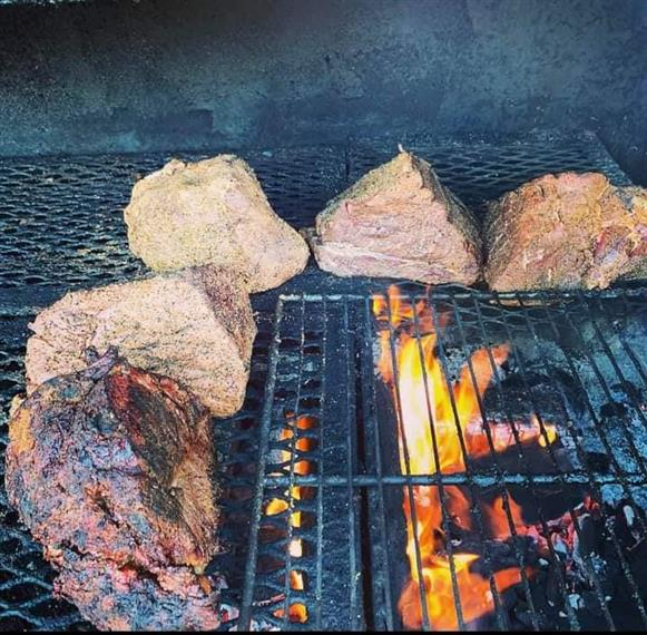 beef cooking in the smoker