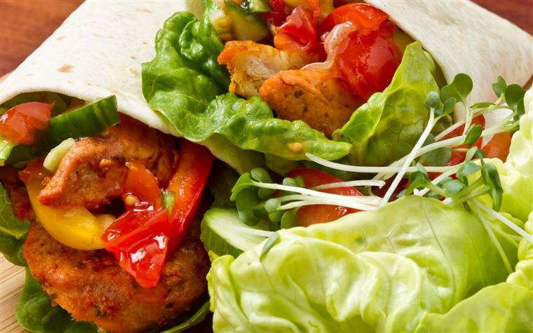 Buffalo chicken wrap with lettuce and tomato