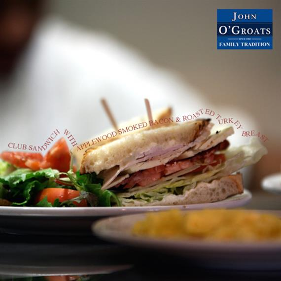 club sandwich with turkey, cheese, lettuce, tomato and side salad