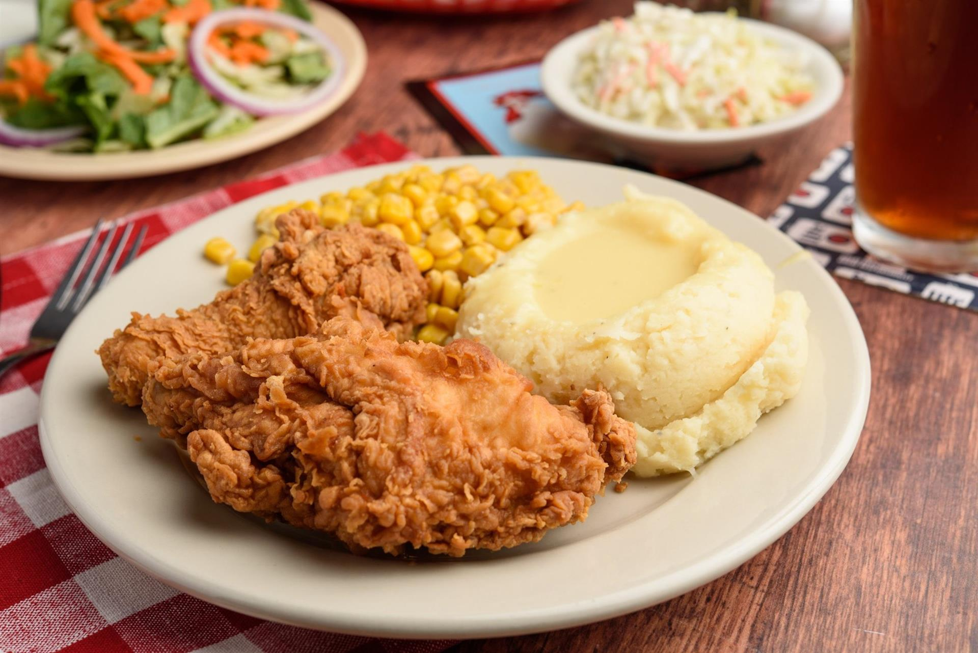 Fried Chicken with mashed potatoes and corn topped with gravy