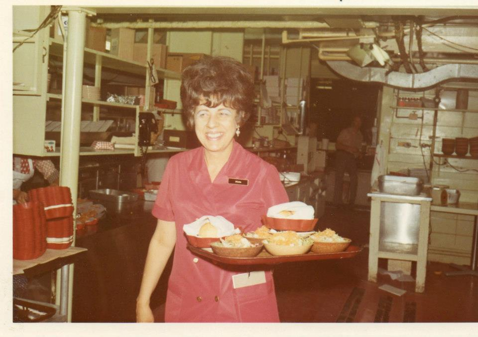 vintage photo of a woman carrying a food tray