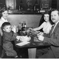 vintage photo of family eating at a table