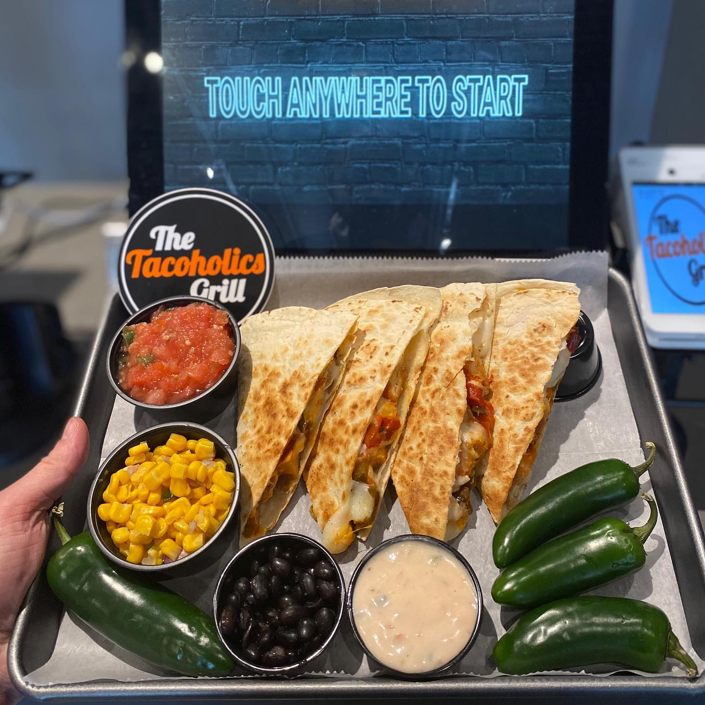 quesadillas with peppers and a variety of sides