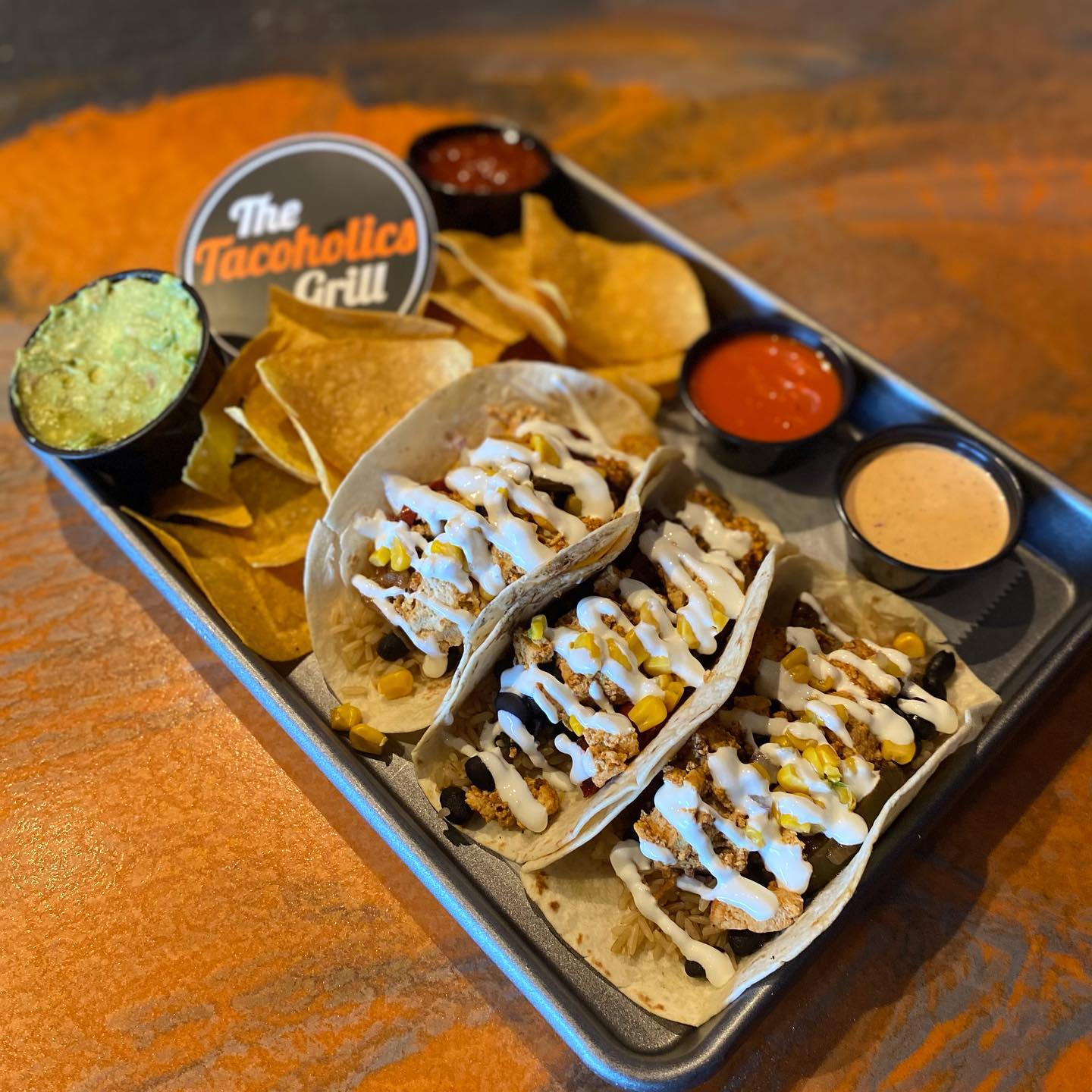 3 tacos with chips and salsa, guac, and queso to dip