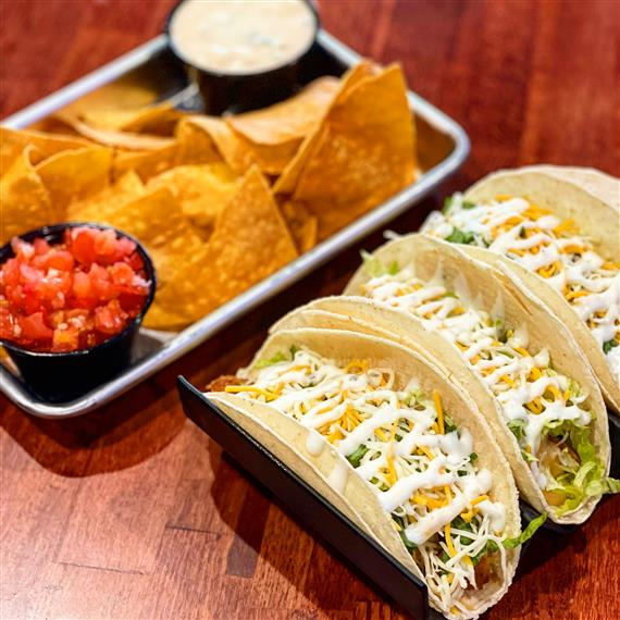 3 tacos with chips, salsa and queso