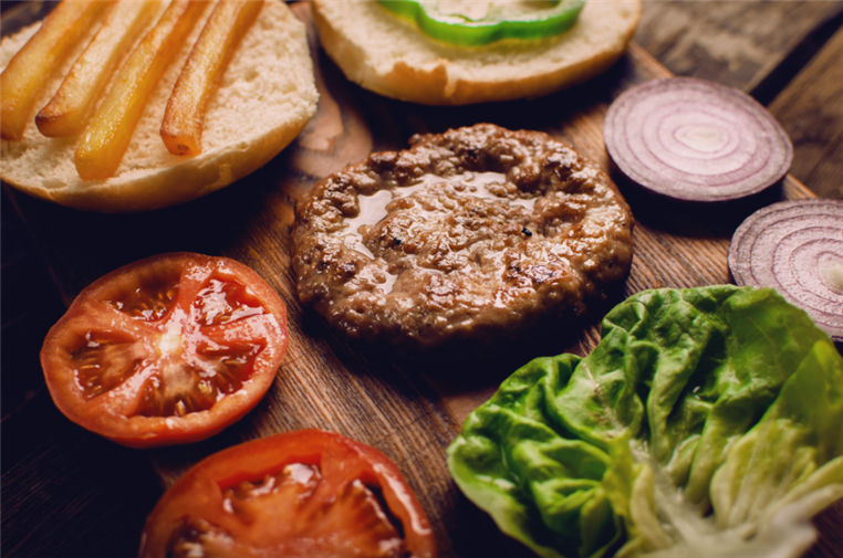 burger ingredients on a cutting board