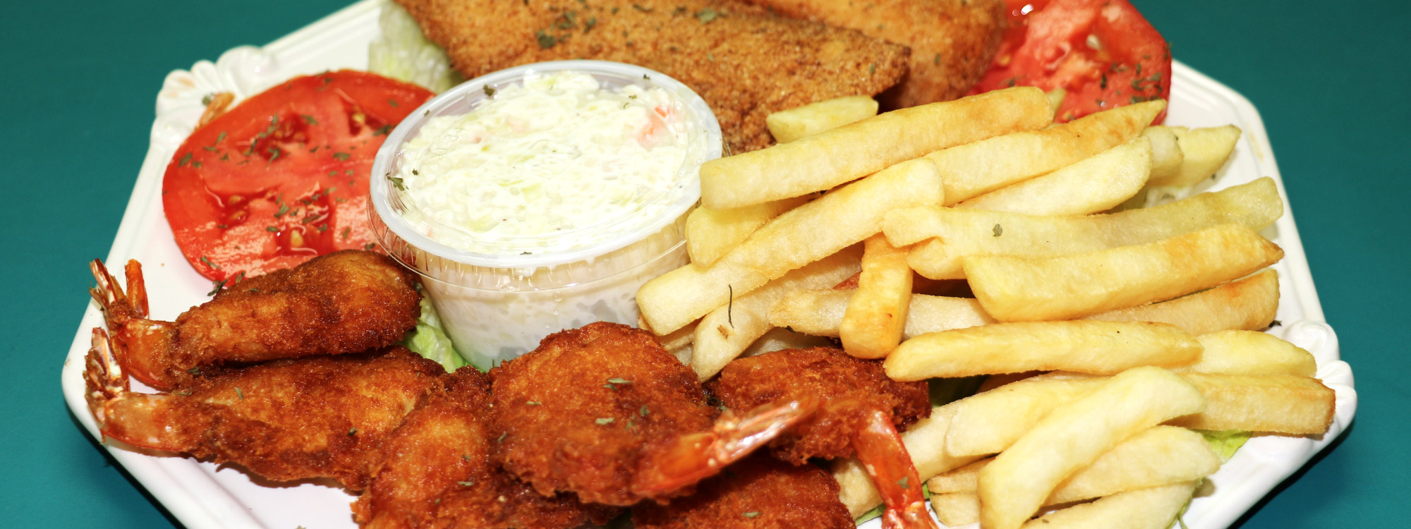 coconut shrimp with fish, fries, and tomato