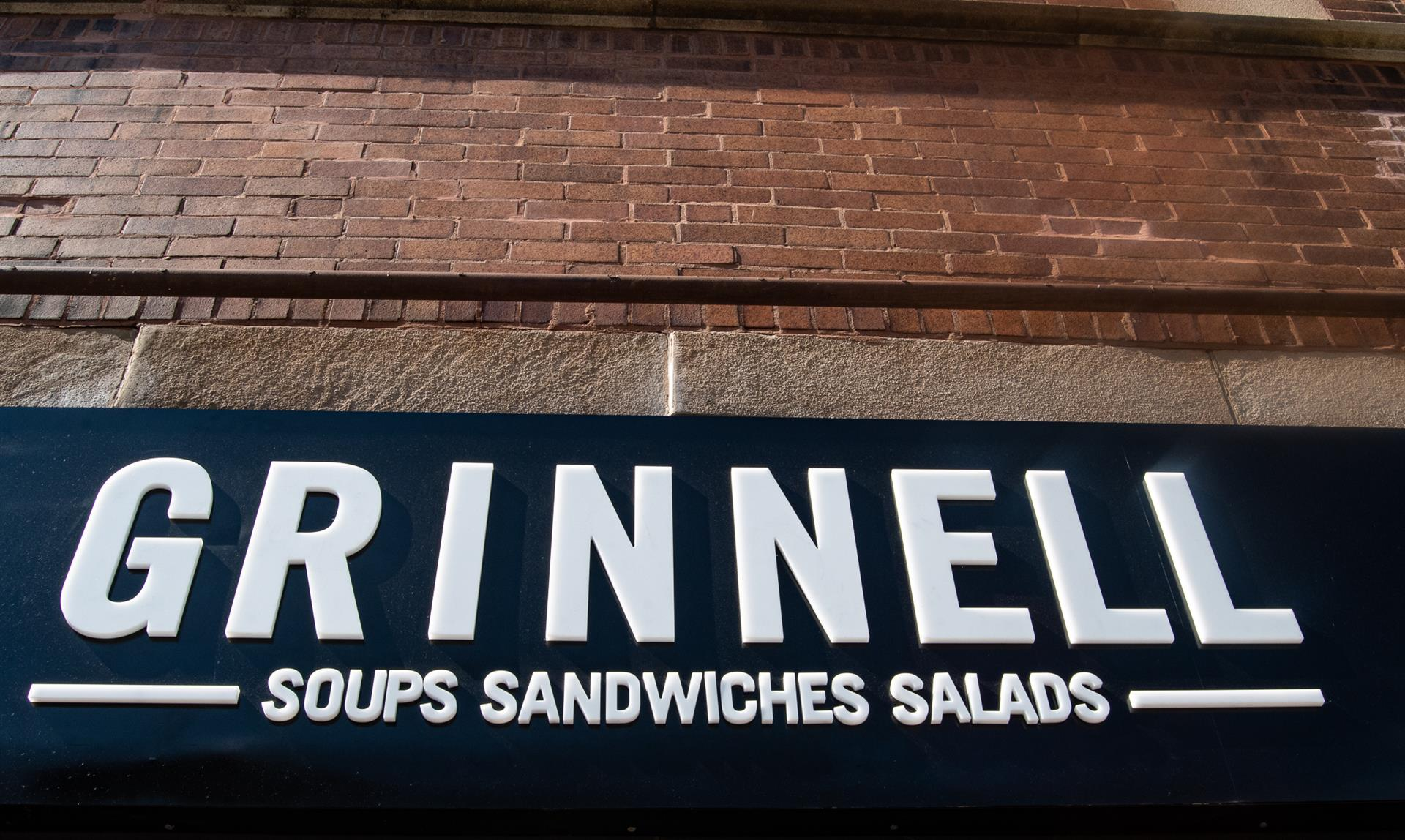 grinnell soups salads sandwiches sign